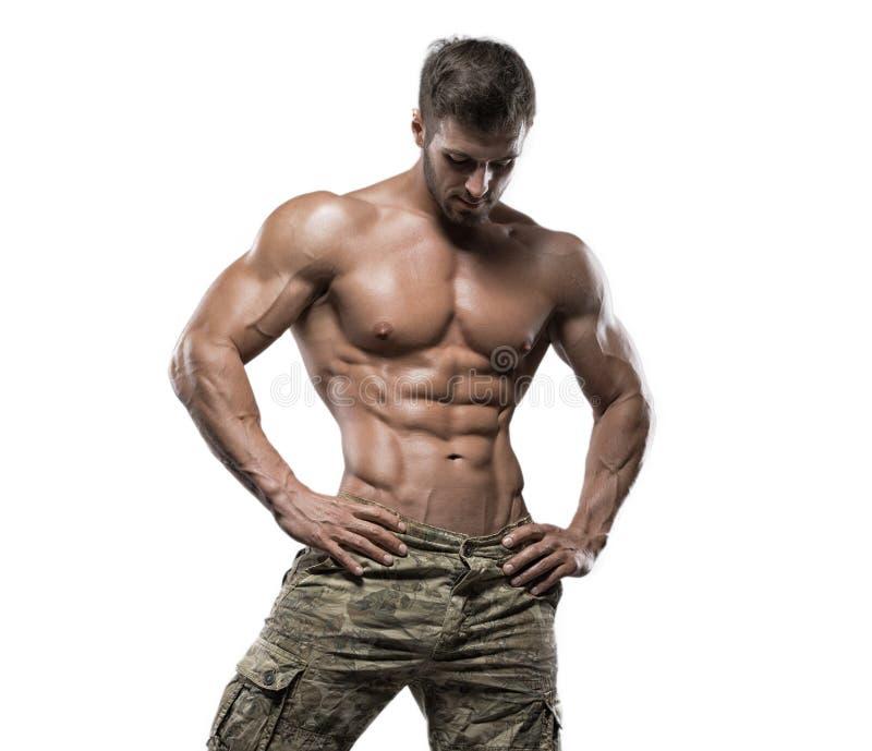 Type musculaire de bodybuilder d'isolement au-dessus du fond blanc photographie stock