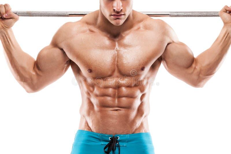 Type musculaire de bodybuilder faisant des exercices avec des haltères au-dessus de whi photo libre de droits