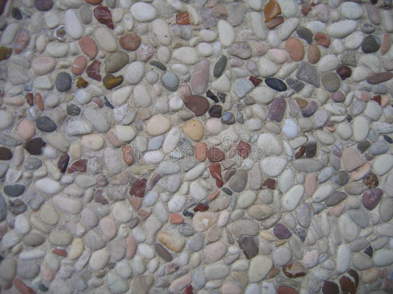 Type vue de fond de petites roches sur une route de trottoir photo stock