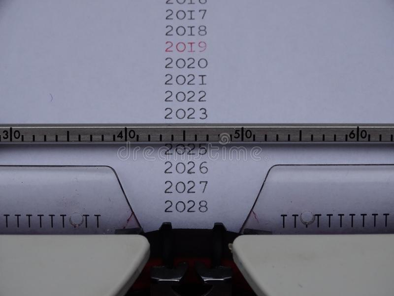 Typed Years in black 2019 in red. On electric typemachine white paper stock photo
