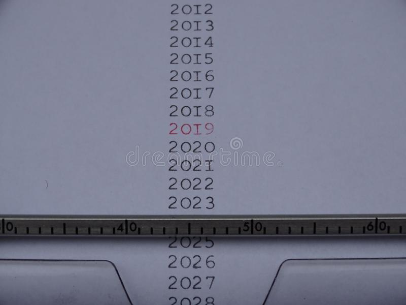 Typed Years in black 2019 in red. On electric typemachine white paper stock photos