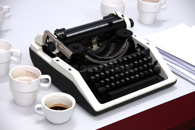Typewriter. On the desk with cup of coffee stock photo