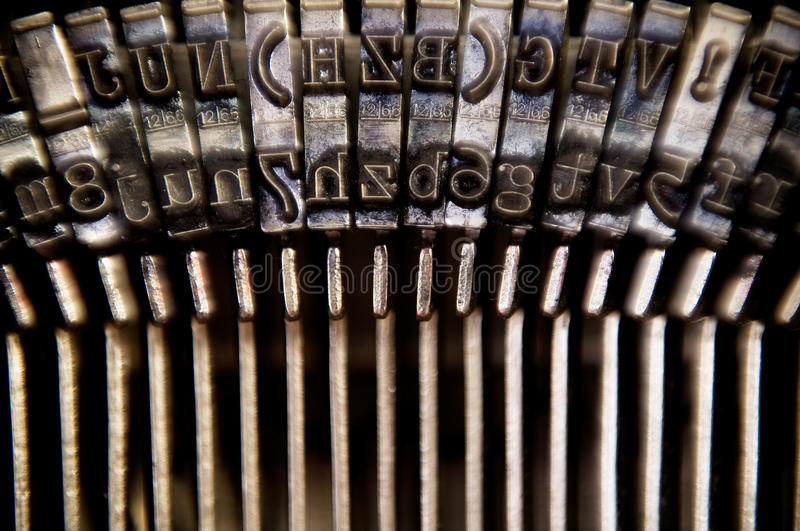 Typewriter. Macro typebars on antique typewriter royalty free stock photo