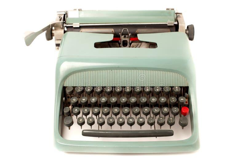 Typewriter. Retro typewriter front view isolated on white royalty free stock photo