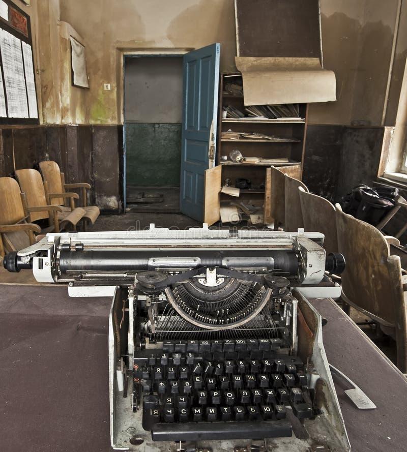 Typewriter. Old typewriter in an abandoned room royalty free stock photo