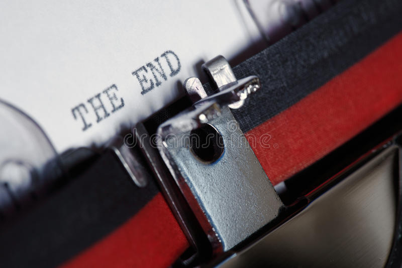 Typewriter - The End. Close-up of an old fashioned antique typewriter with the words the end stock image