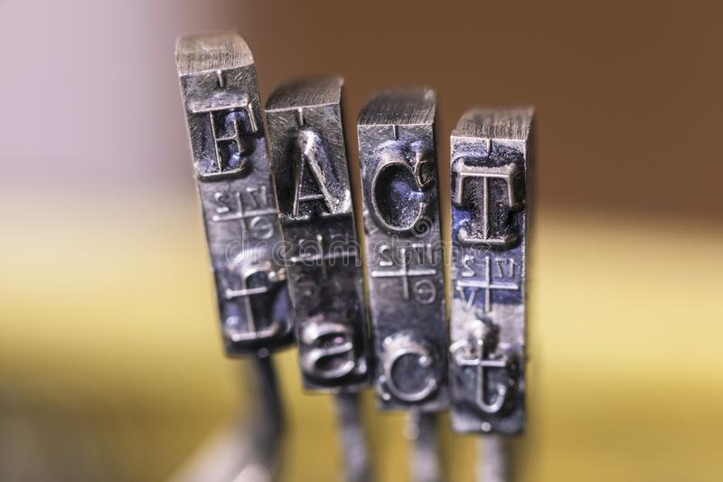 Typewriter FACT. Macrophotography of typewriter hammers with FACT word royalty free stock photo