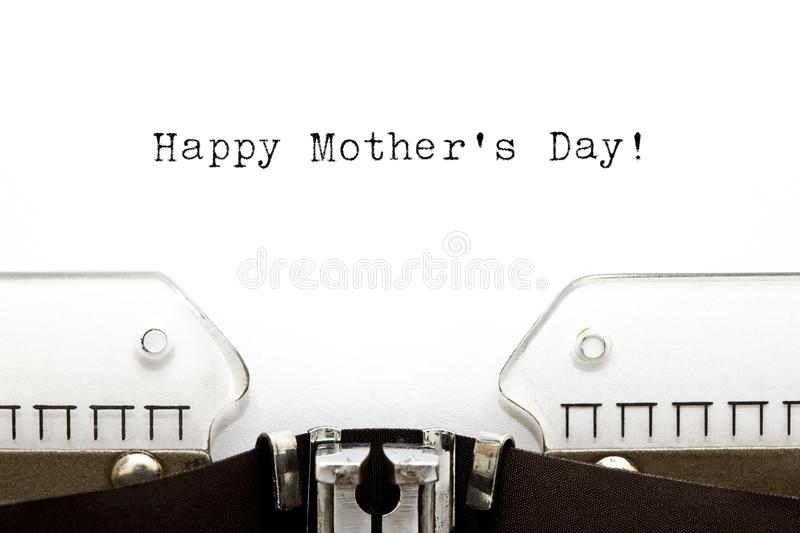 Typewriter Happy Mothers Day. Happy Mothers Day greeting printed on an old typewriter stock photos