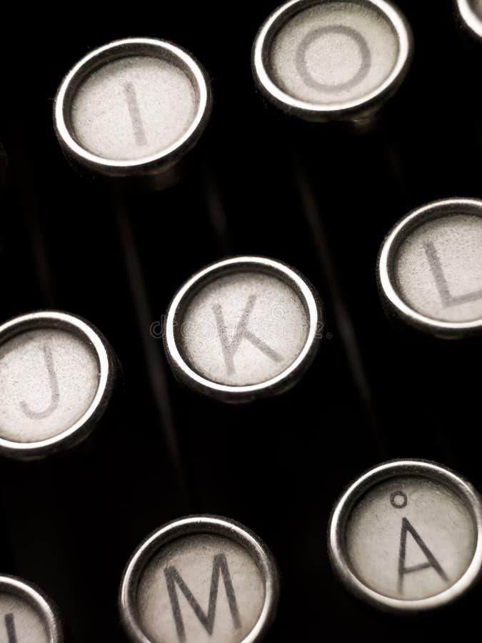 Typewriter Keys. Close up of vintage typewriter keys stock photo