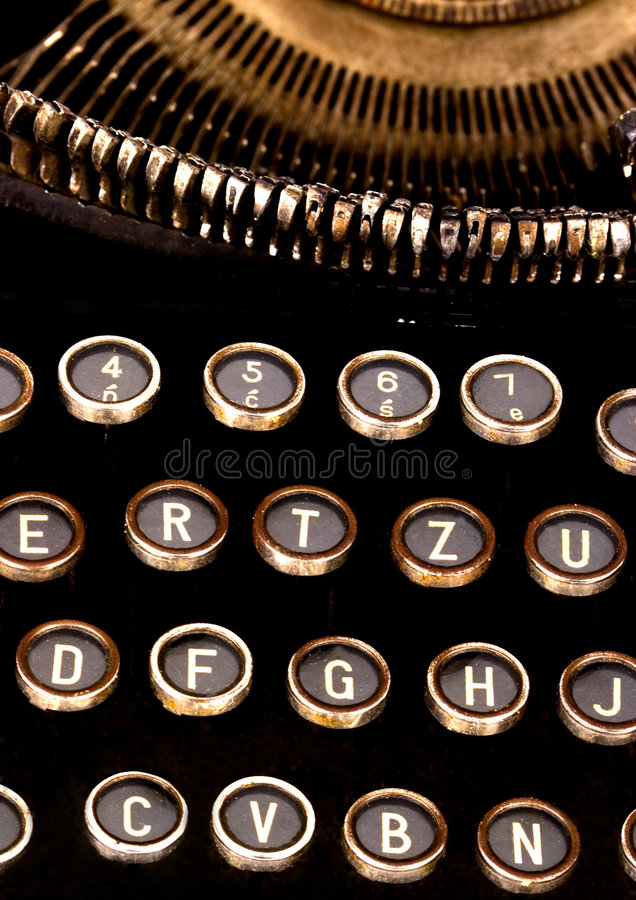Typewriter keys. A typewriter is a mechanical, electromechanical, or electronic device with a set of keys that, when pressed, cause characters to be printed on a royalty free stock photo