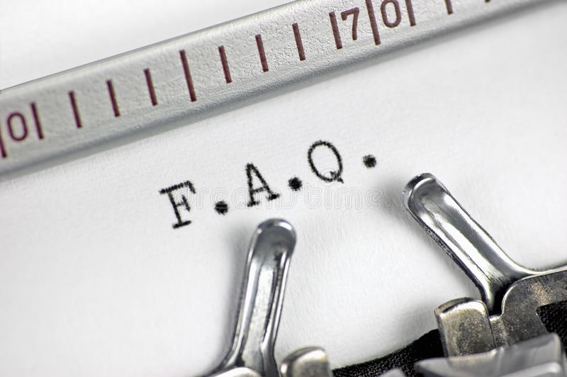 Typewriter macro closeup, typing FAQ. Typewriter large macro closeup, typing FAQ royalty free stock photos