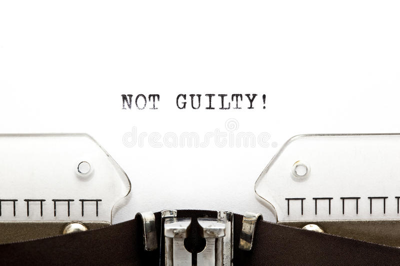 Typewriter NOT GUILTY. Concept image with NOT GUILTY! written on an old typewriter royalty free stock image