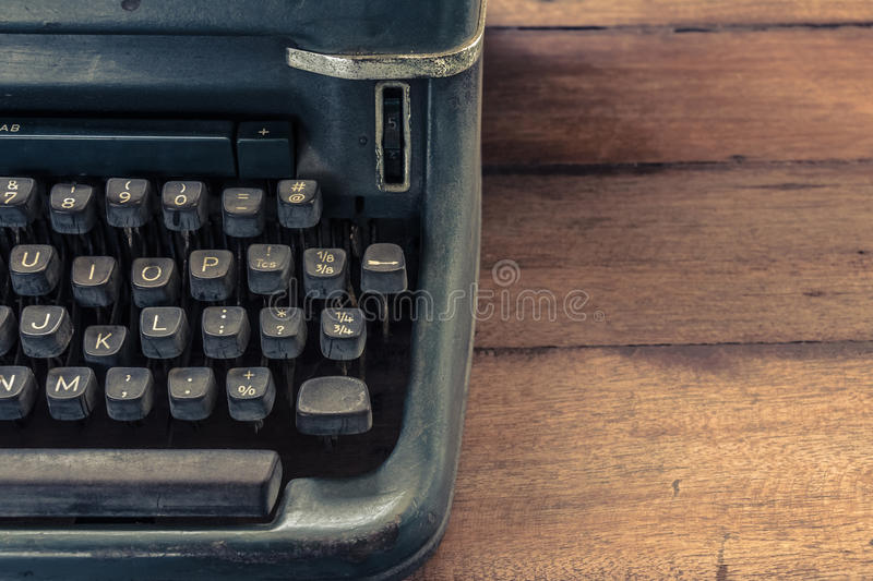 Typewriter. Old typewriter on wood table stock images