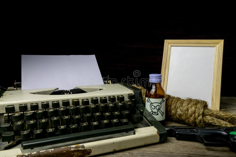 Typewriter with paper page and poison and gun. Concept writer Romance Suspense. Closeup royalty free stock photography