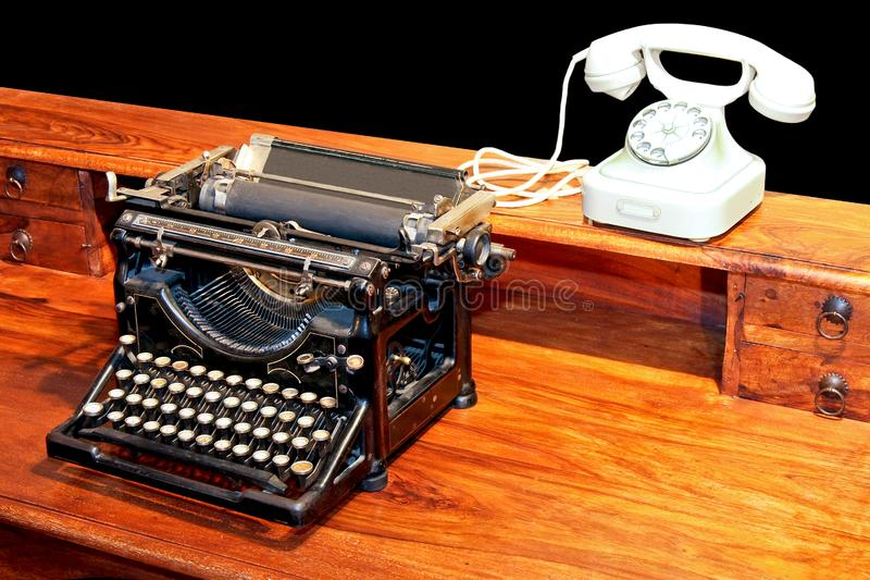 Typewriter and phone stock photos