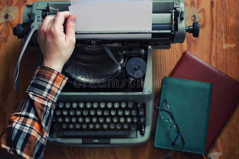 Typewriter retro hand on wooden table. Various vintage elements on old worn backgrounds different concepts stock photography