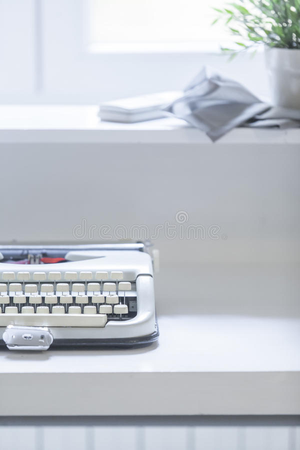Typewriter. On the table with plant stock photography