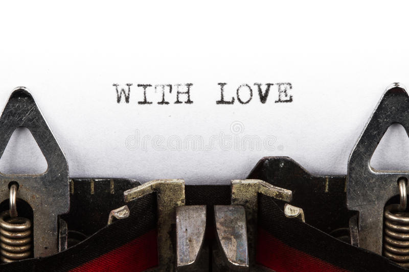 Typewriter with text with love. Old typewriter with text with love royalty free stock image