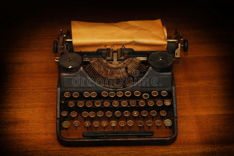 Typewriter. Vintage ink typewriter with a blank page stock photography