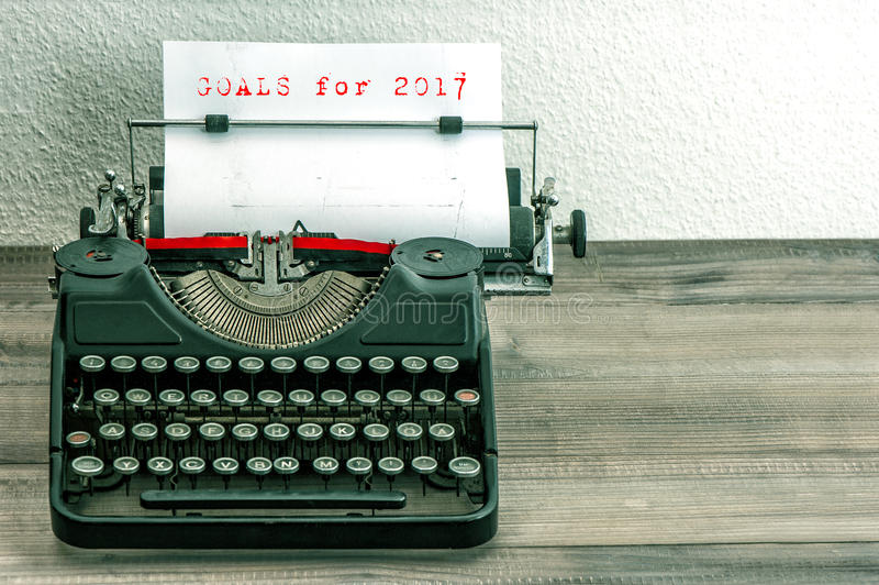 Typewriter white paper page Goals 2017. Typewriter with white paper page on wooden table. Goals for 2017. Vintage style toned picture royalty free stock photo