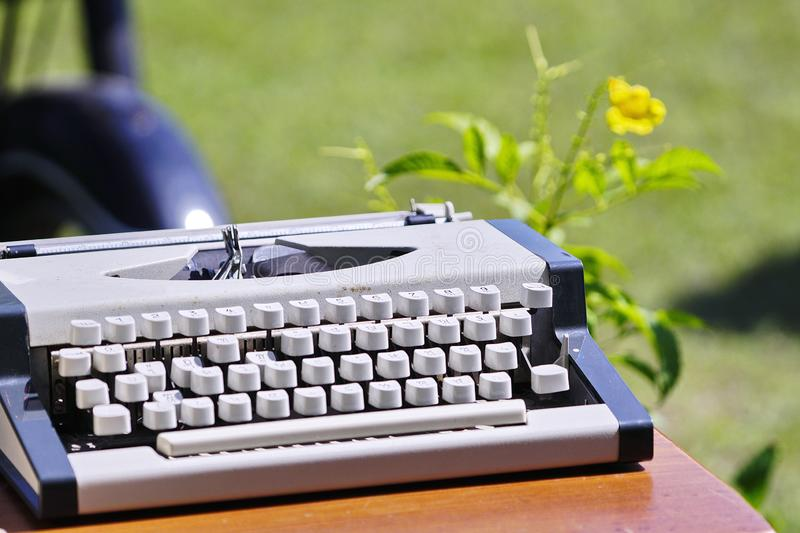 Old Pink Typewriter From The 1950s With Blank Paper, Coffee And
