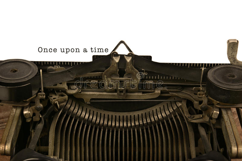 Typewriter With The Words Once Upon a Time. An old fashioned typewriter with the words Once upon a time. Closeup of the antique machines ribbon and carriage stock photos