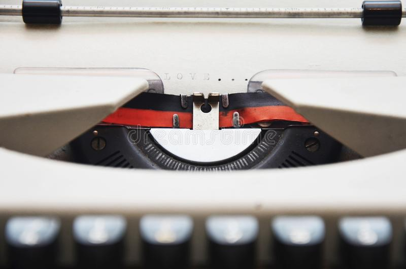 Typewritter with the word LOVE royalty free stock photography