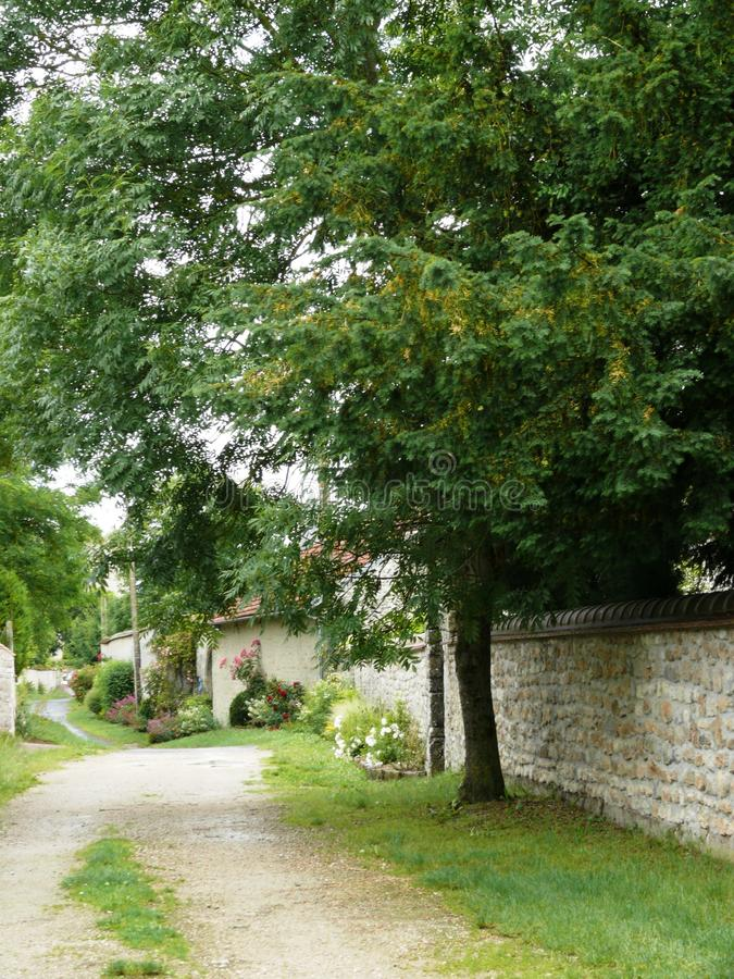 Typical alley in the medieval village of Yevre chatel stock photo