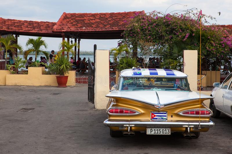 The typical american classic car parked in Cienfuegos, Cuba. stock photo