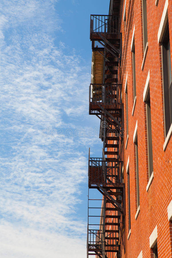 The typical american fire escape ladder zigzagging across the fa royalty free stock photos