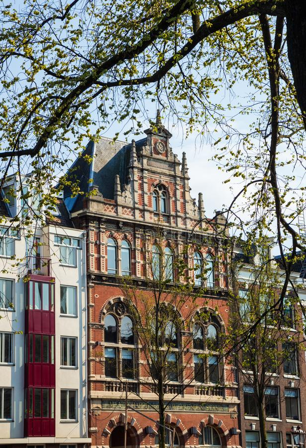 Typical Amsterdam canal house for support of the employed, Amsterdam royalty free stock image