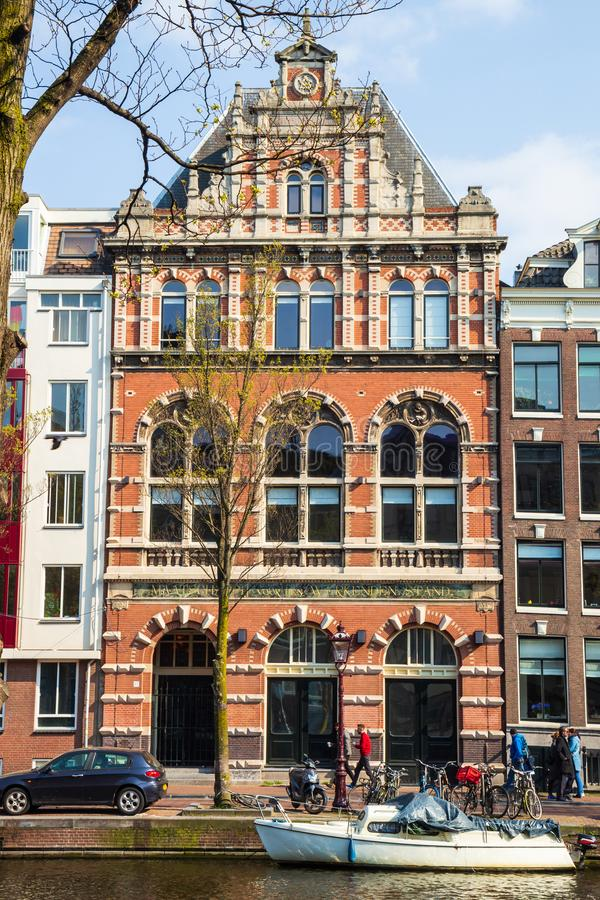 Typical Amsterdam canal house for support of the employed in Amsterdam royalty free stock photos