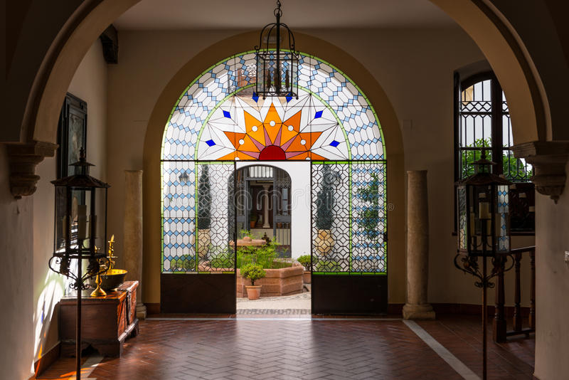 Typical andalusian style patio in Cordoba. Detail of the access and glass door of a patio in a typical house in Córdoba, Spain stock image