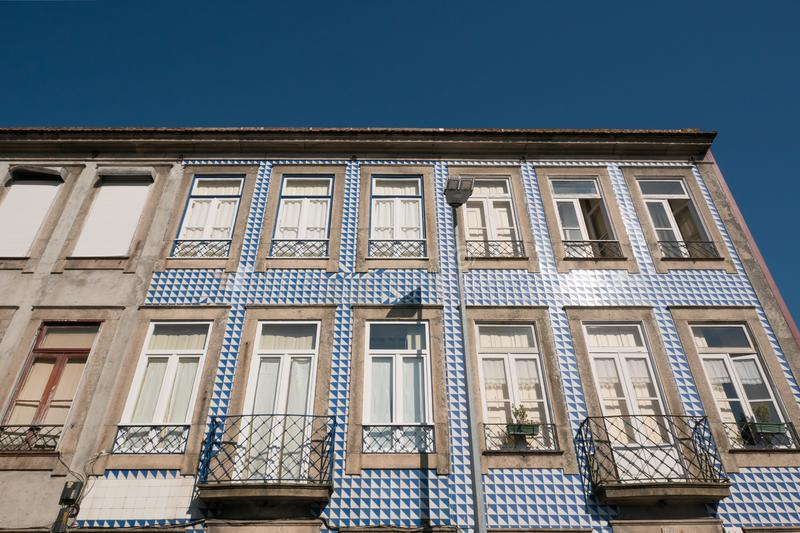 Typical apartment building in Porto, Portugal with traditional azulejos blue tiles. royalty free stock photos