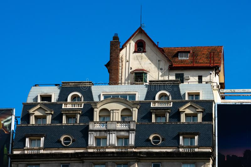 Typical argentine chalet house on top of a building on July 9 Avenue royalty free stock photography