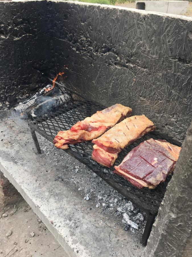 Meat on barbecue. Typical Argentinian style barbecue stock images