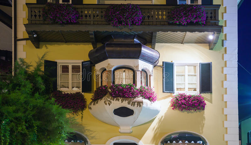 Typical Austrian guesthouse at night in St. Gilgen stock photo