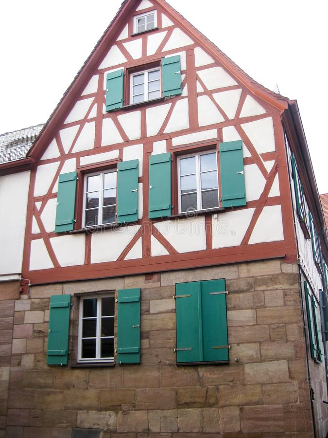Typical Bavarian fachwerk house, Furth, Germany. Typical Bavarian fachwerk house with green shutters in old town of Furth, Germany, close view stock photography