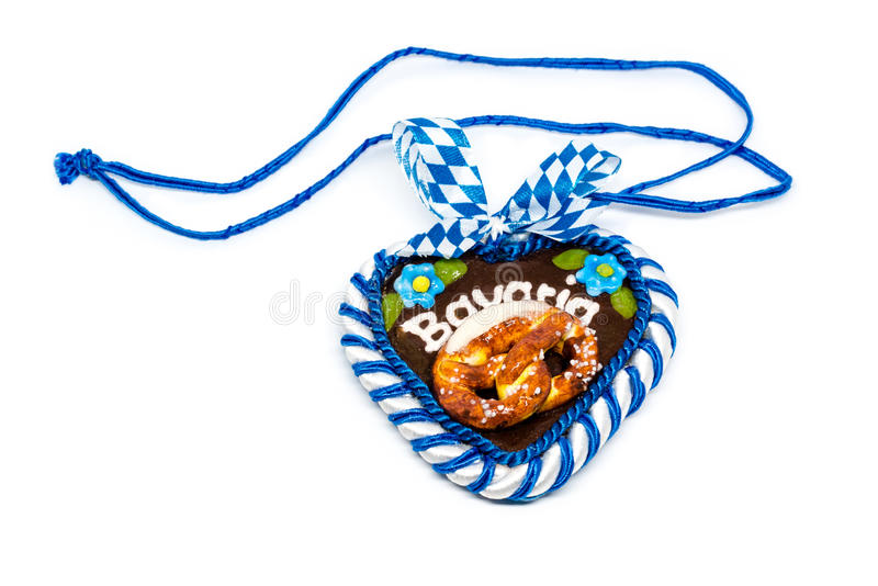 Typical bavarian oktoberfest heart with clipping path on white stock photography
