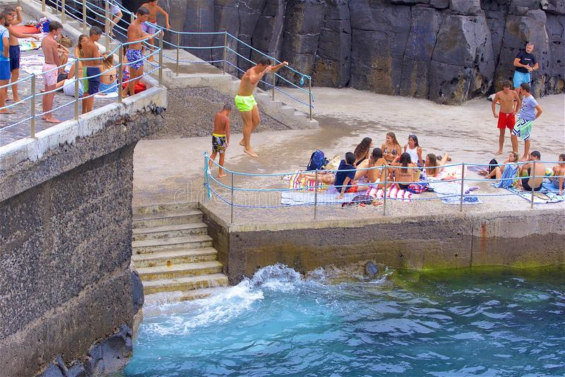 Typical beaches in Madeira, Portugal. Swimming and sunbathing in Madeira beaches, Portugal royalty free stock photography