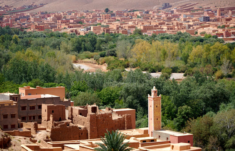 Typical berber village whit oasisi of the atlas mountains in Morocco. Morocco Atlas mountains. Village with red earth Just one hundred kilometers from the exotic royalty free stock photo