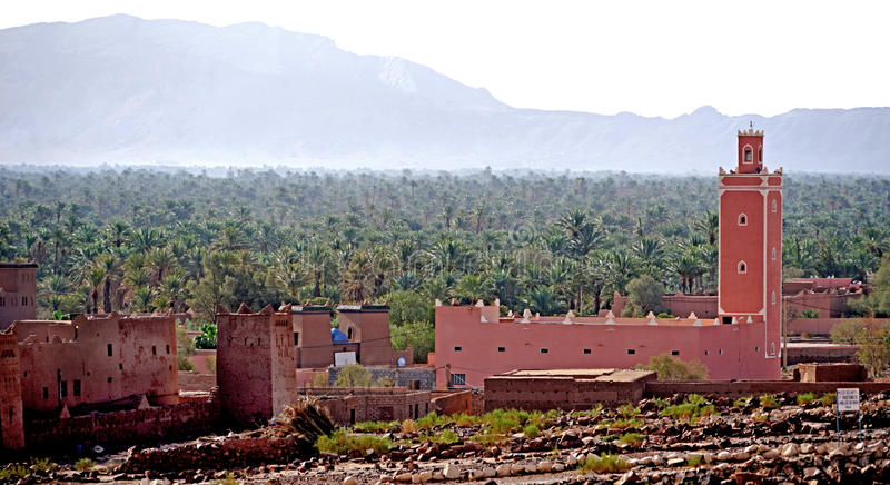 Typical berber village whit oasisi of the atlas mountains in Morocco. Morocco Atlas mountains. Village with red earth Just one hundred kilometers from the exotic royalty free stock photos