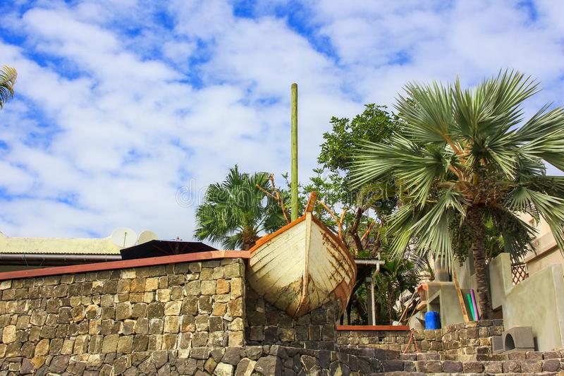 Typical black stones fasade wall and entrance to a traditional Mauritian countryside house on the seashore stock photos