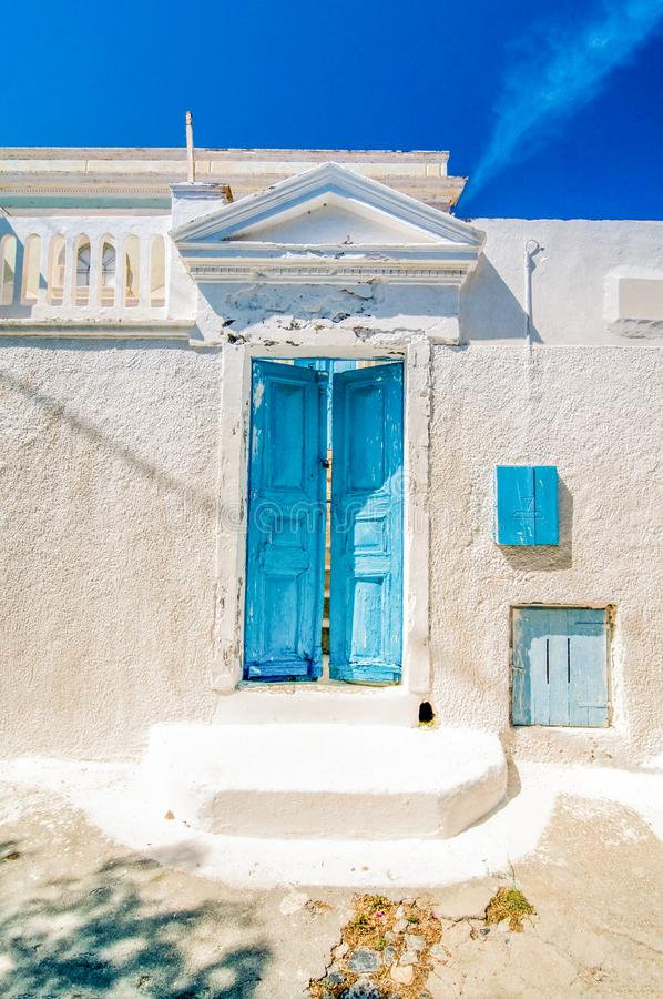 Typical blue door in Emporio on the island of Santorini, Greece,. Typical blue door in Emporio on the island of Santorini, Greece. Dramatic toned stock photo