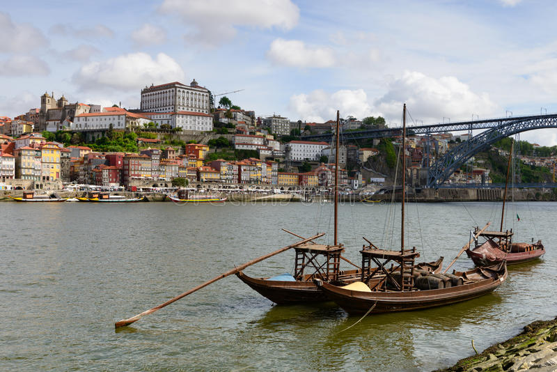 Typical boats of Dour River and the historic center of Oporto. Panoramic landscape of Porto and the amazing Dom Luis Bridge linking the two banks of the Douro stock photo
