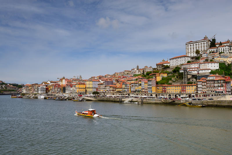Typical boats of Dour River and the historic center of Oporto. Panoramic landscape of Porto and the amazing Dom Luis Bridge linking the two banks of the Douro royalty free stock photography