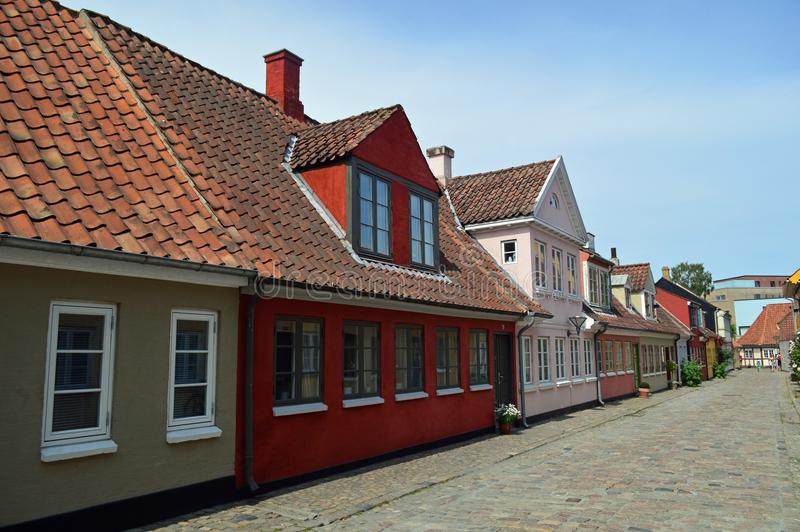 Typical Brightly coloured 17th century danish town houses on a cobbled street. Typical Brightly coloured 17th century danish town houses in Odense denmarks third royalty free stock photography