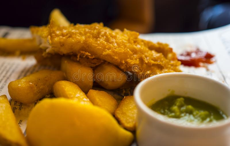 Typical British Pub Food - the famous Fish and Chips royalty free stock photos