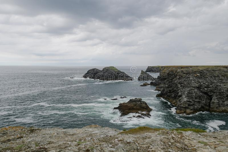 Typical brittany coastline with grey cloudy sky and immensity of atlantic ocean royalty free stock images