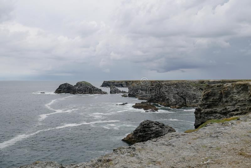 Typical brittany coastline with grey cloudy sky and immensity of atlantic ocean stock image